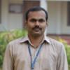 Prof. Tomson Devis